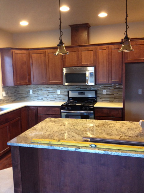 Contemporary Kitchen: Granite with Stained Cabinets