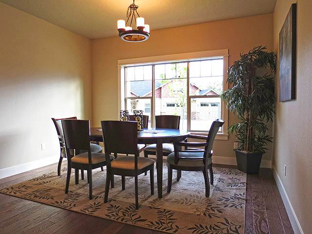 Well-Appointed Dining Room with Hardwood Floors
