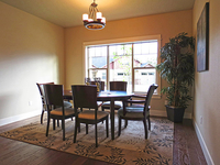 Well-Appointed Dining Room with Hardwood Floors thumbnail